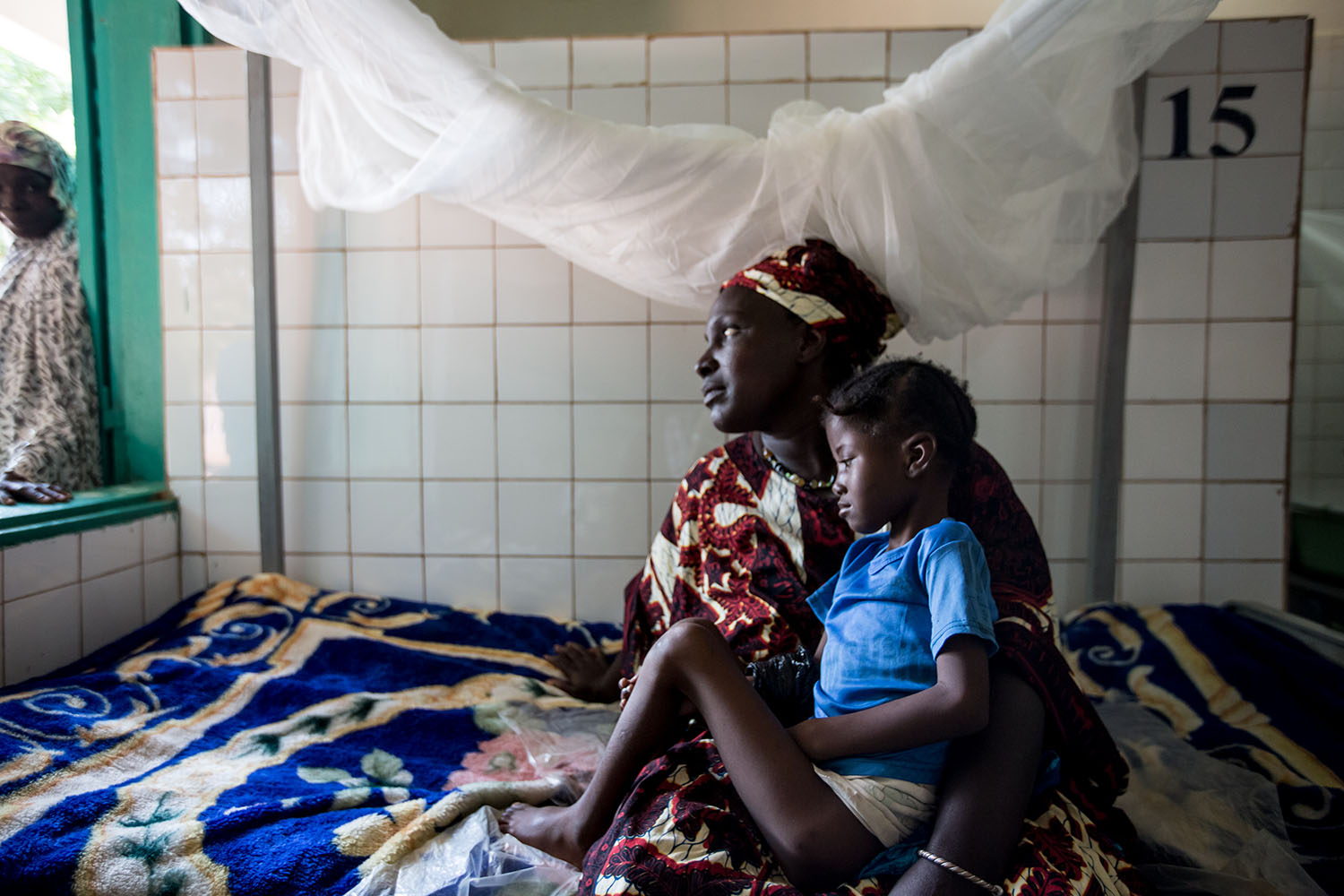 A mother and child at the local hospital where they are admitted and the child is treated for severe acute malnutrition. Chronic malnutrition has an irreversible impact on a child's growth and development. According to UNICEF, more than two in every thr