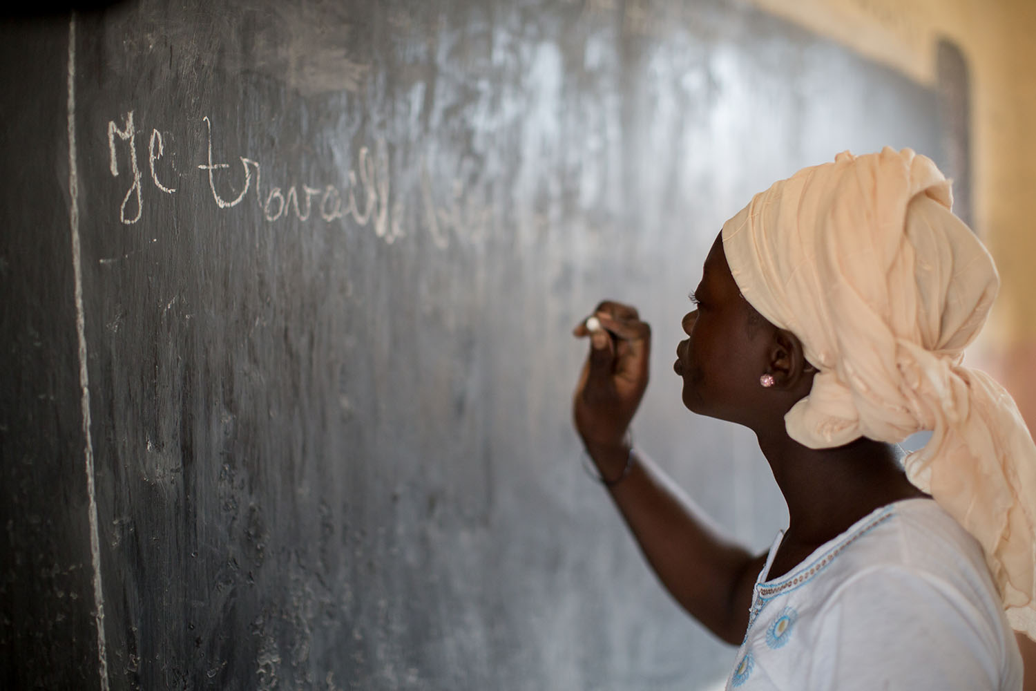 Abibatou Togola, 15 years, (released) writes on the black board at school. 45 – 50% of the population of Mali cannot read or write. But Mali's education system remains largely unequal and unfair, especially for girls who are often forced into early ma