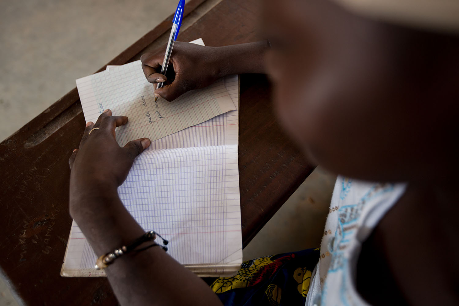 UNICEF is facilitaes adult literacy programs, where illiterate parents are taught to read and to write so that they can assist their children at home with school work. This helps the children with their grades and constantly reinforces to the parent how v