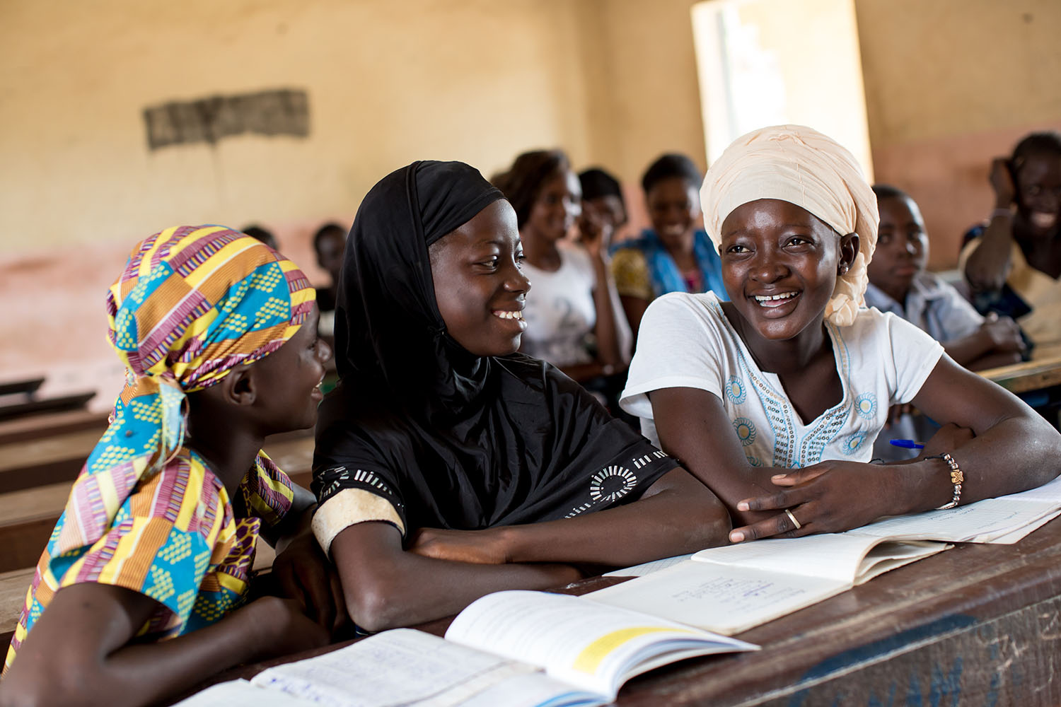 Abibatou Togola, 15 years (released) and her friends engage in a discussion during class at Koumantou Secondary School, Sikasso Mali. As UNICEF's focus on educating the girl child in Mali continues, one would hope that these young girls are at least giv