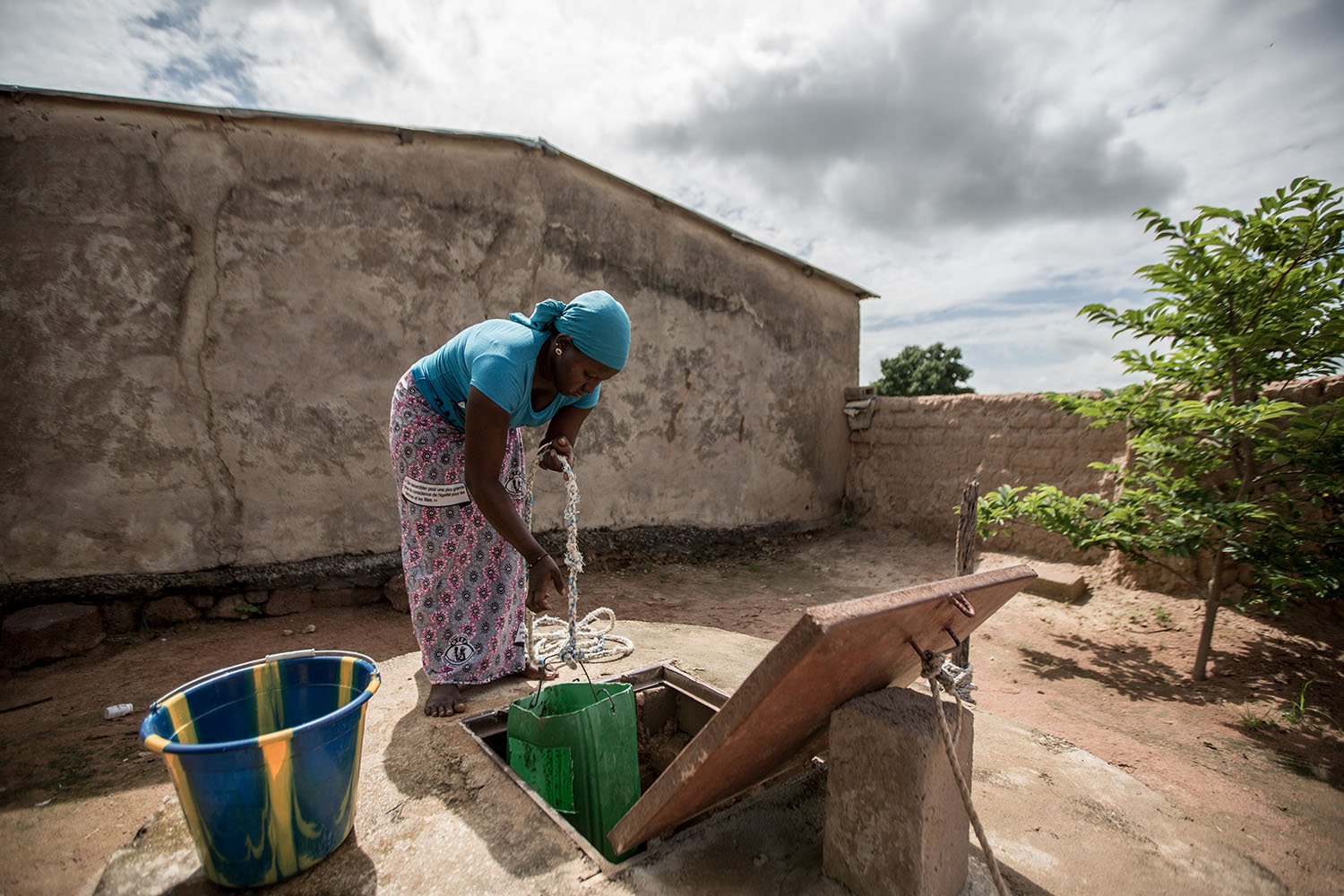 Waraba Doumbia,16 years (released) fetches water from their well at home. Before a girl even gets to school, she has prepared breakfast for the family, cleaned the homestead and taken care of all her younger siblings. When she gets home in the afternoon,