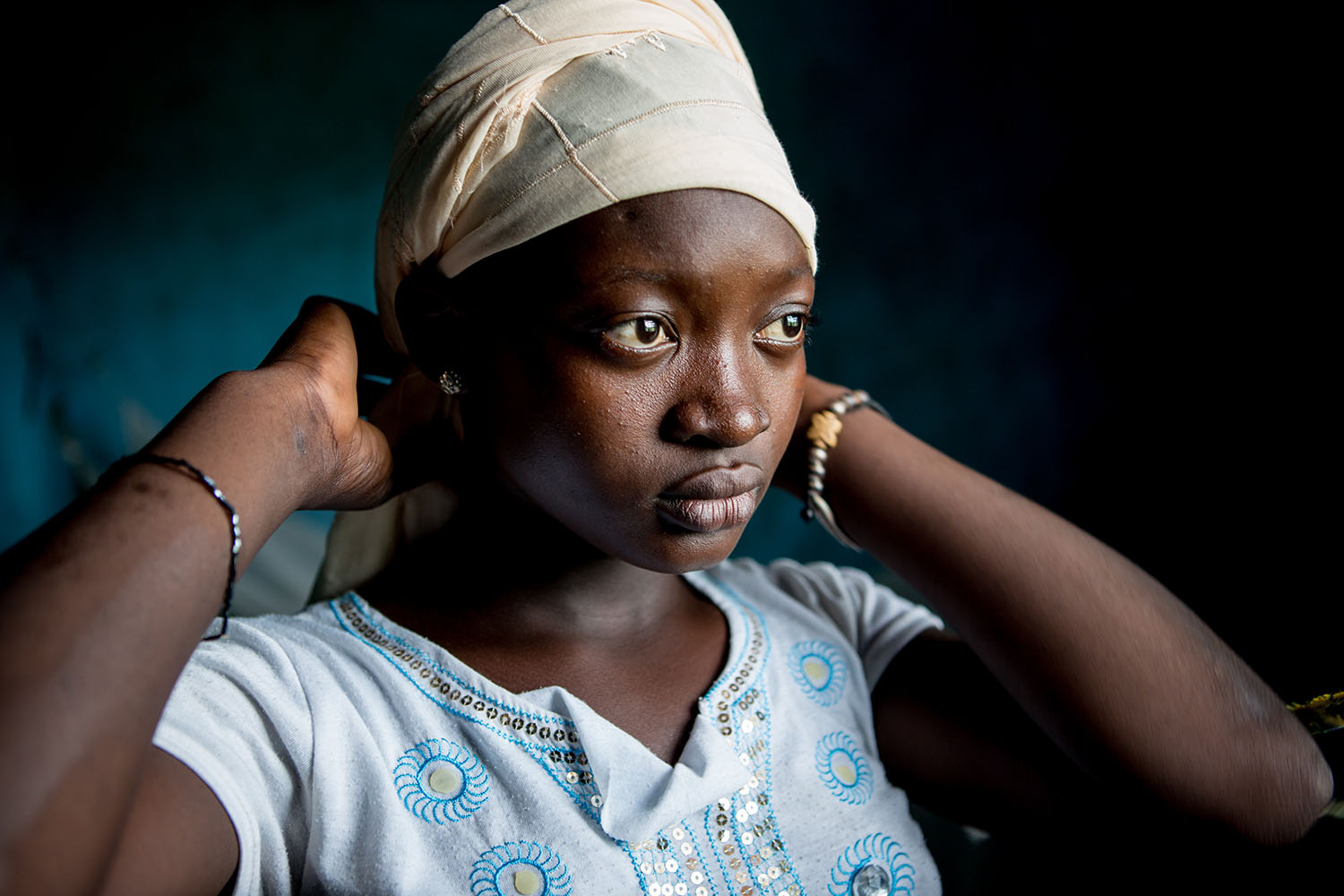 """Abibatou Togola, 15 years old (released) attends Koumantou Secondary School. She is about to complete Grad 8. According to her teacher, she is a courageous student, a """"fighting girl"""". Her grades are good. """"I think she will be able to pursue her drea"""