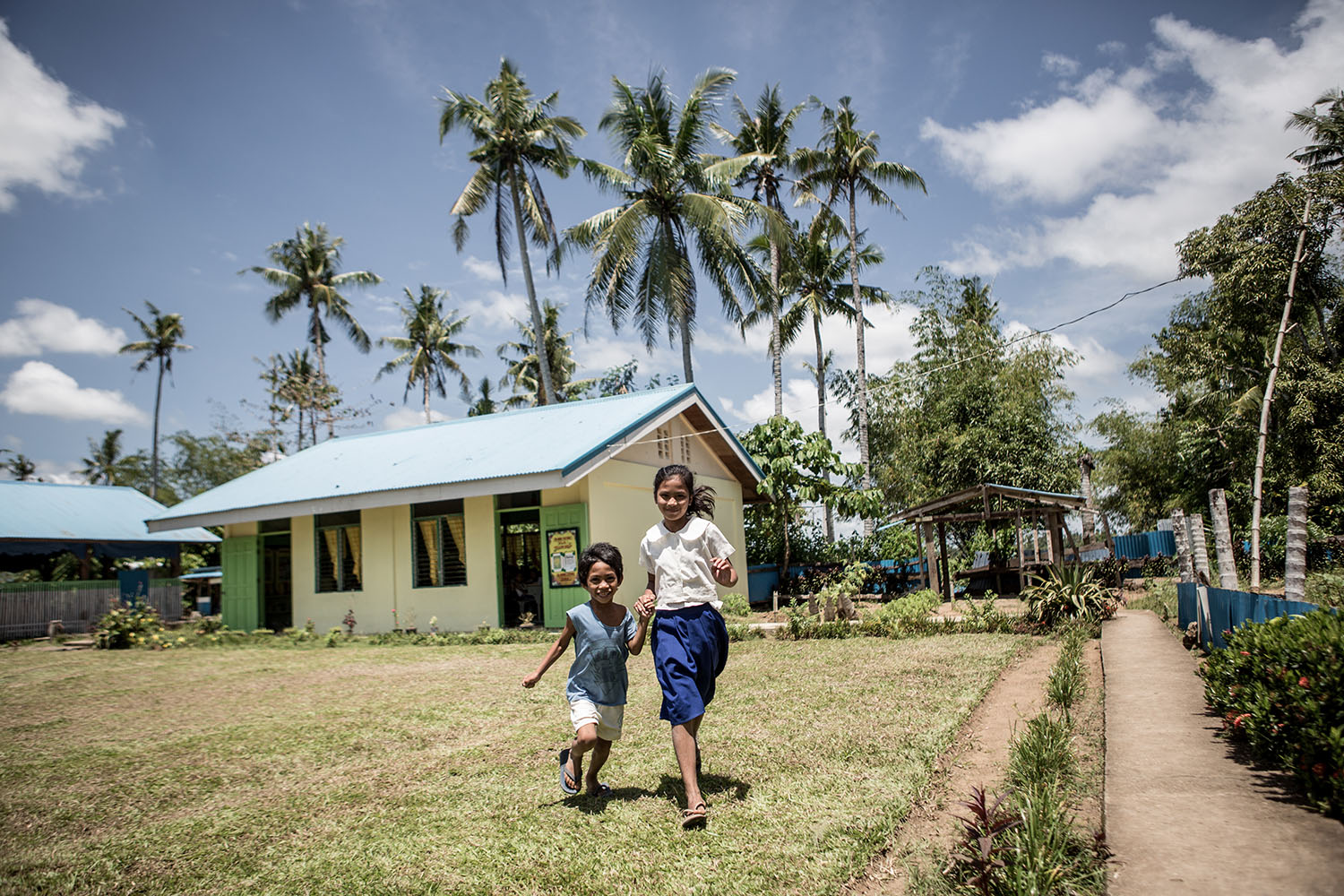 Maria Lourdes Tolibas (Inchang)  and her brother Francisco Tolibas Maghulod Elementary School, Leyte UNICEF trip to Tacloban, in the Philipines to report on their response to Typhoon Yolanda, March 2016