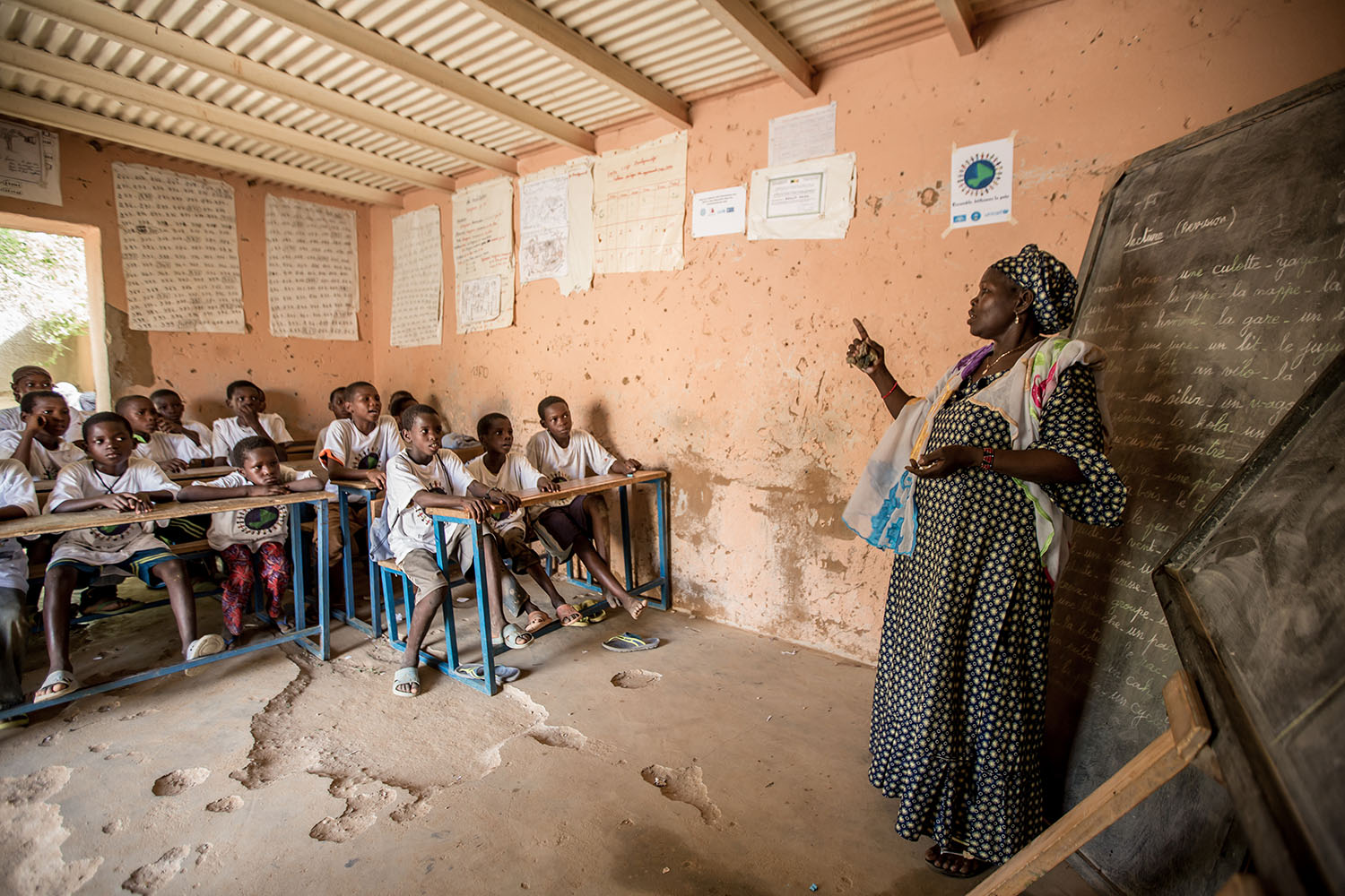 A teacher takes a maths class at the Accelerated Learning Center of Bourougoundye, Gao where ongoing conflicts in the northern regions of Mali continue to have devastating effects education. UNICEF supports the re-opening of schools and alternative educat