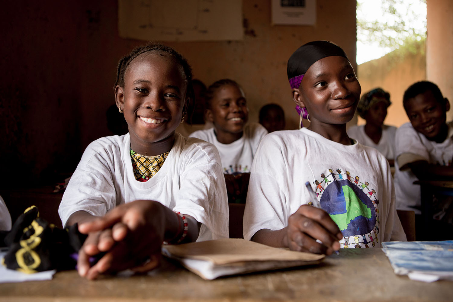 Adeoula and a classmate (RELEASED) enjoy class together in the Accelerated Learning Centre of Bourougoundye, Gao where ongoing conflicts in the northern regions of Mali continue to have devastating effects education. UNICEF supports the re-opening of scho