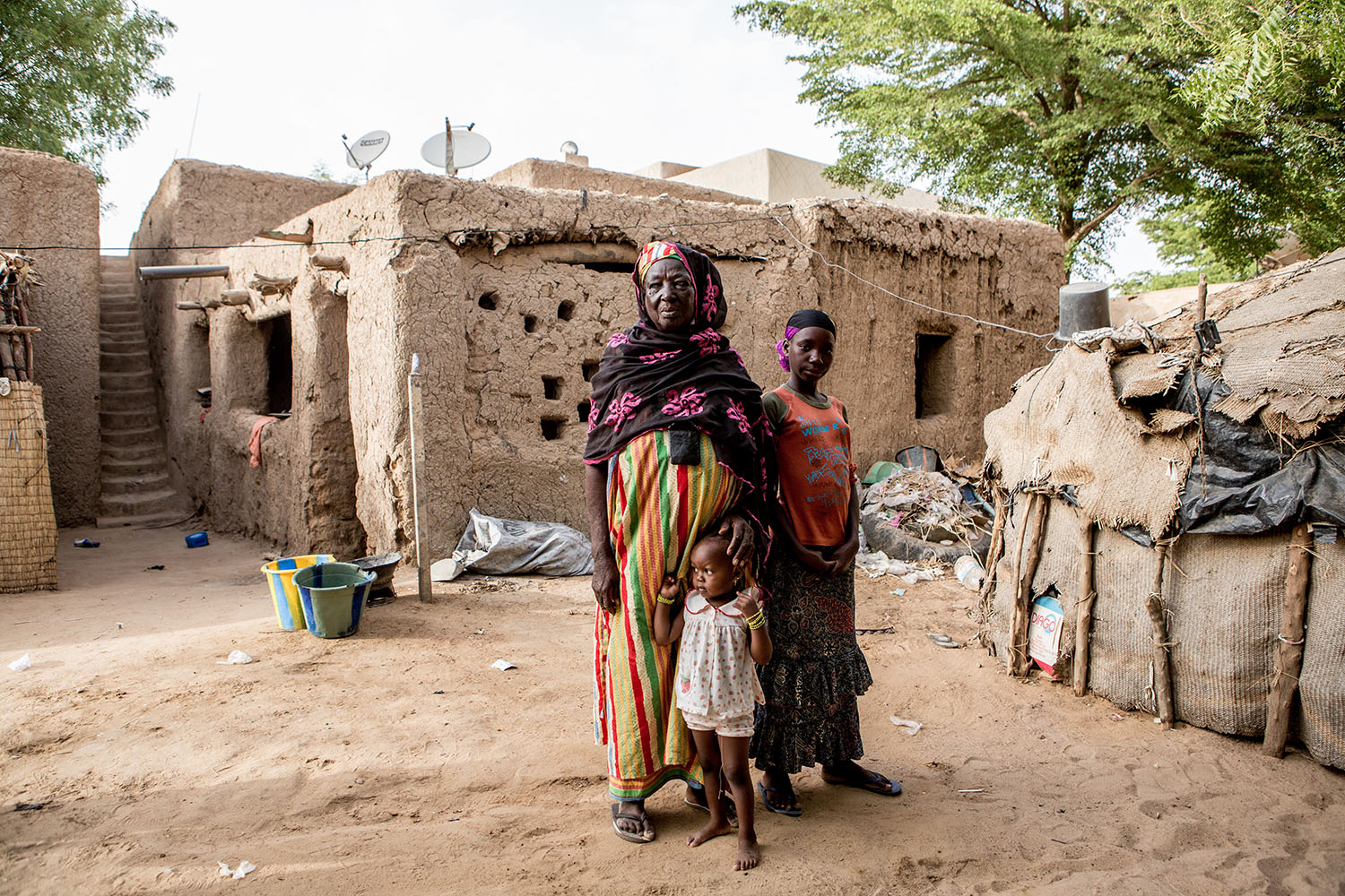 Portrait of Grandma Hadish and Adeoula (RELEASED) at their homestead, Gao Northern Mali. Adeoula and her brother were orphaned during the conflict and live with their grandmother Hadish. Ongoing conflicts in the northern regions of Mali continue to have d