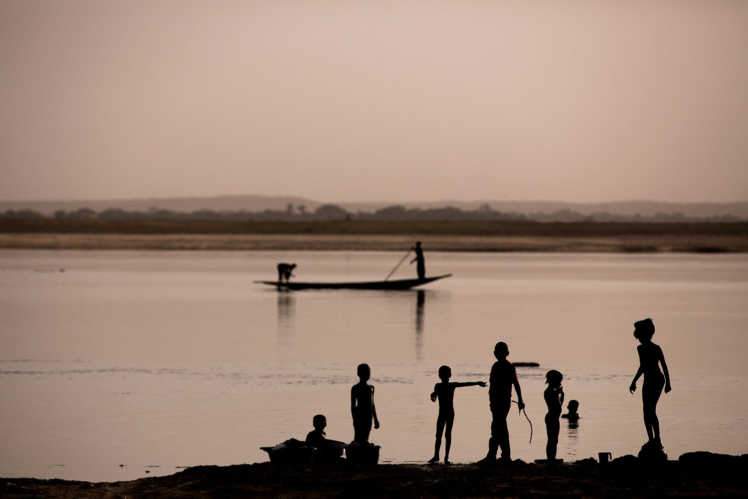 Children playing on the banks of the Niger River, where in 2012 armed Islamic rebels attacked the city of Gao, in Northern Mali and opened fire on civilians.  Ongoing conflicts in the northern regions of Mali continue to have devastating effects education