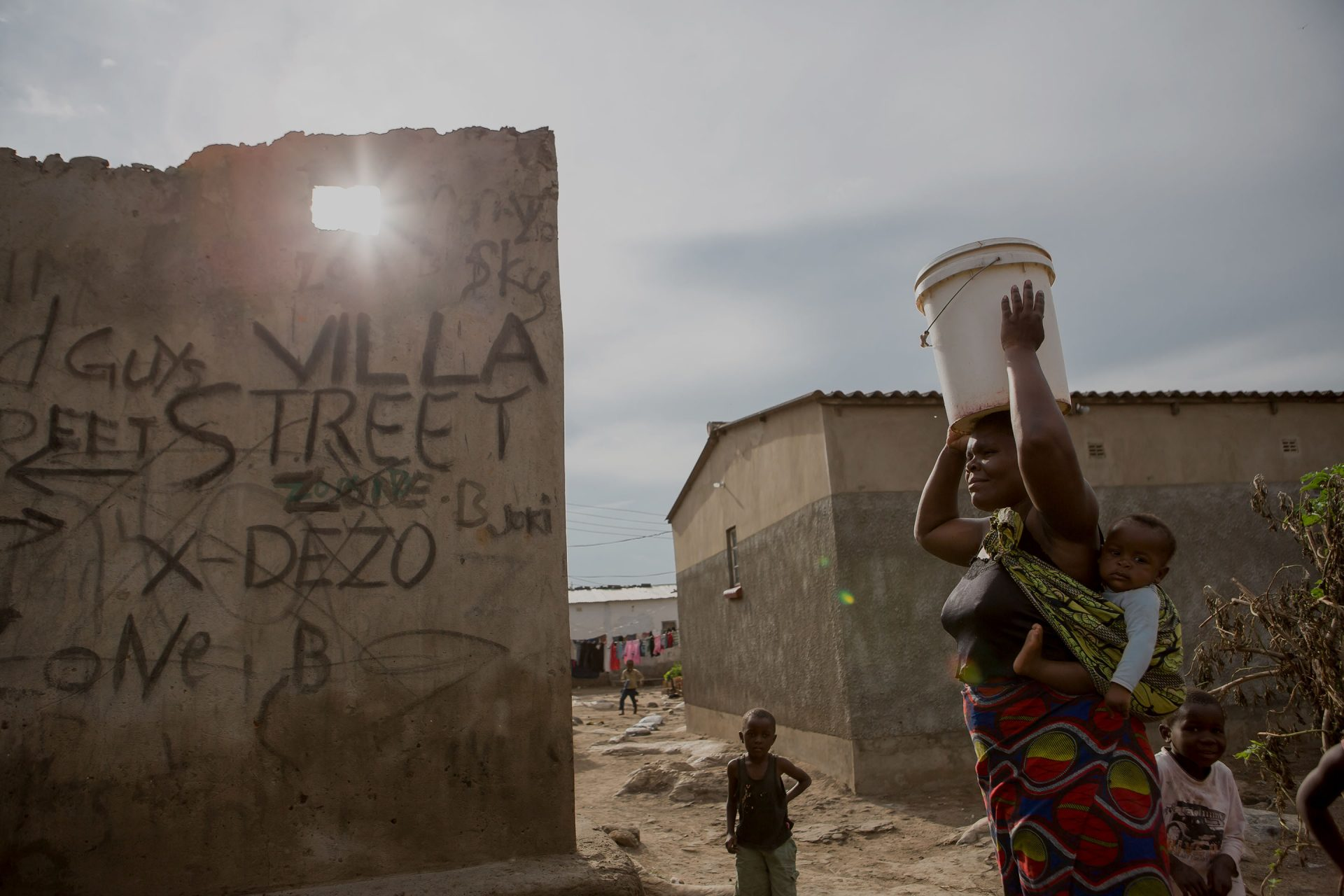 In Lusaka, Zambia, a mother carries water home. Life for women in Zambia can be challenging. They can find it hard to refuse their husbands sex, or to insist their partner use a condom. More than 30% of partnered women aged 15 to 24 in Zambia have experie