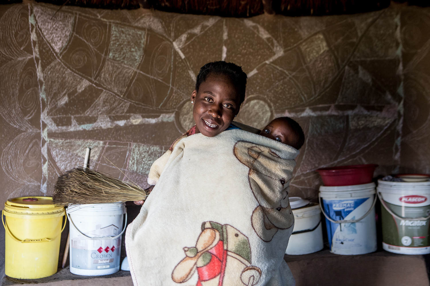 "Maitumeleng Leteketa (22 yrs) and her baby Tsele Leteketa (8 months) in their home in the Ha Khapiso Village in Lesotho, where Community - Led Total Sanitation (CLTS) has been embraced and implemented by the village. New latrines, and hand washing ""tippy"